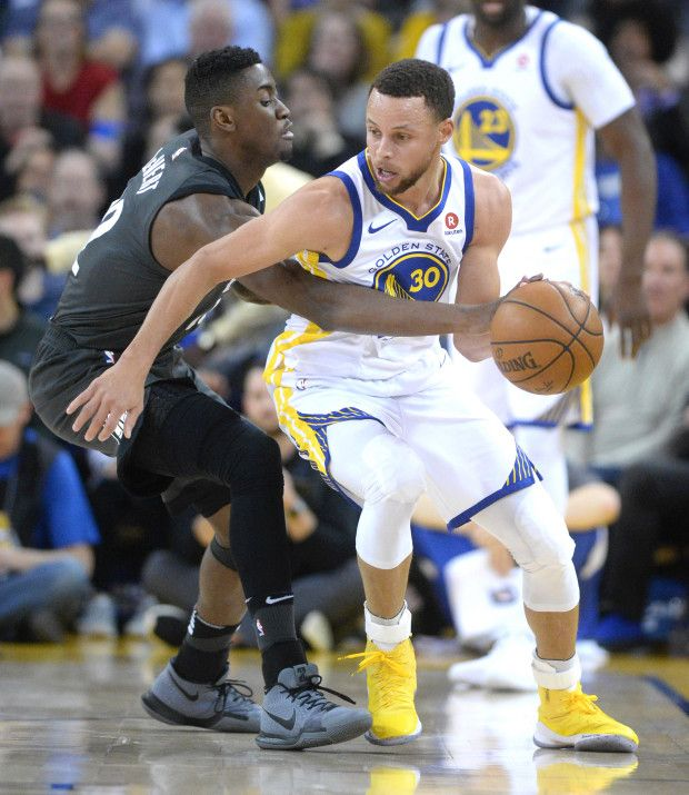 Brooklyn Nets Caris Levert 22 Tries To Steal The Ball From Golden State Warriors Stephen Curry 30 In The Fir Warriors Stephen Curry Warrior Stephen Curry