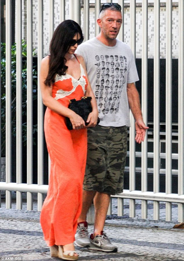 Monica Bellucci looks glamorous on holiday with her husband Vincent Cassel wearing low-cut negligee-like dress, February 2013.