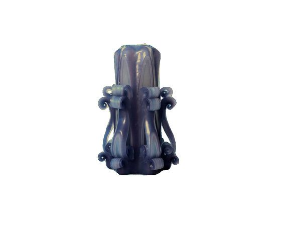 This beautiful Fading Traces hand carved marbled purple candle stands at approximately 6 inches tall, in a six point star design the tapers down.