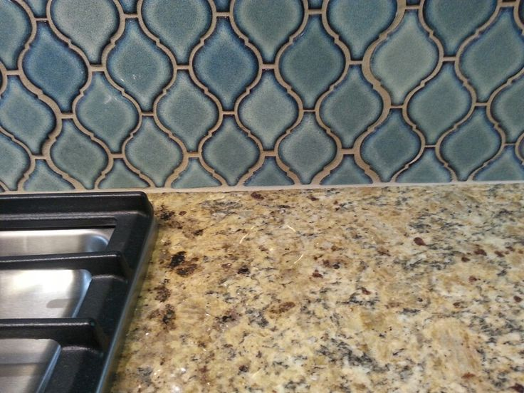 Close Up New Venetian Gold Granite Countertop With Blue