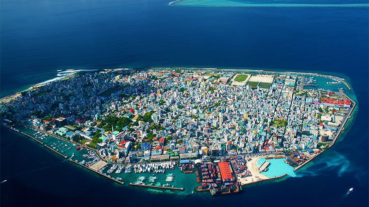 Malé is the capital and most populous city in the Republic of Maldives. With a population of 133,412 and an area of 5.8 km2, it is also one of the most densely populated cities in the world. The city is geographically located at the southern edge of North Malé Atoll (Kaafu Atoll). Administratively, the city consists of a central island, an airport island, and two other islands governed by the Malé City Council.