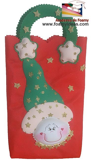 Christmas bag. To have a funny but impressive chrismas packaging for your gifts:). Bolsa para navidad de foamy (or goma EVA) http://www.foamyideas.com/proyectos/proyecto-p11-bella-bolsa-con-espiritu-navideno