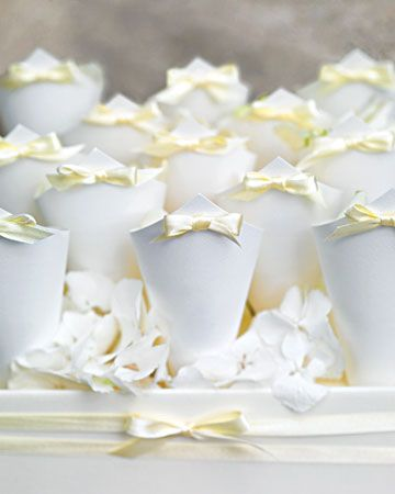elegant -- Paper cones with yellow bows held rose petals for guests to toss