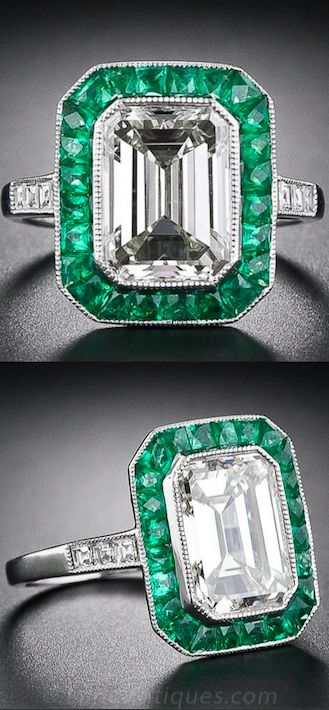 3.00 Carat Emerald Cut Diamond and Emerald Ring, A stunning Art Deco style engagement ring, finely hand crafted in platinum, features a bright and sparking 3.00 carat emerald-cut diamond. The emerald-cut diamond is surrounded by vibrant green, faceted, calibre-cut emeralds with small square-cut accent diamonds enlivening each platinum shoulder. The under gallery is decorated with an elaborate pierced honeycomb motif.