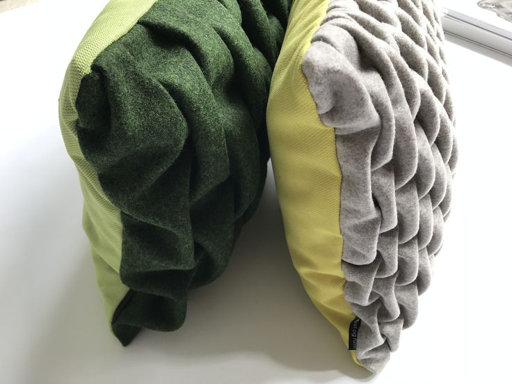 Mobel og rum. SMOCK Cushions. Green/green & Creme/yellow. Hand made in Copenhagen with Kvadrat textiles.