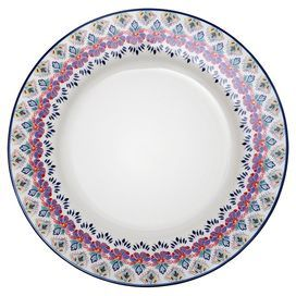 "Porcelain dinner plate with a Southwestern-inspired floral border.  Product: Set of 4 dinner platesConstruction Material: PorcelainColor: White and multiFeatures: In-glaze decalDimensions: 10.5"" Diameter eachCleaning and Care: Microwave and dishwasher safe"