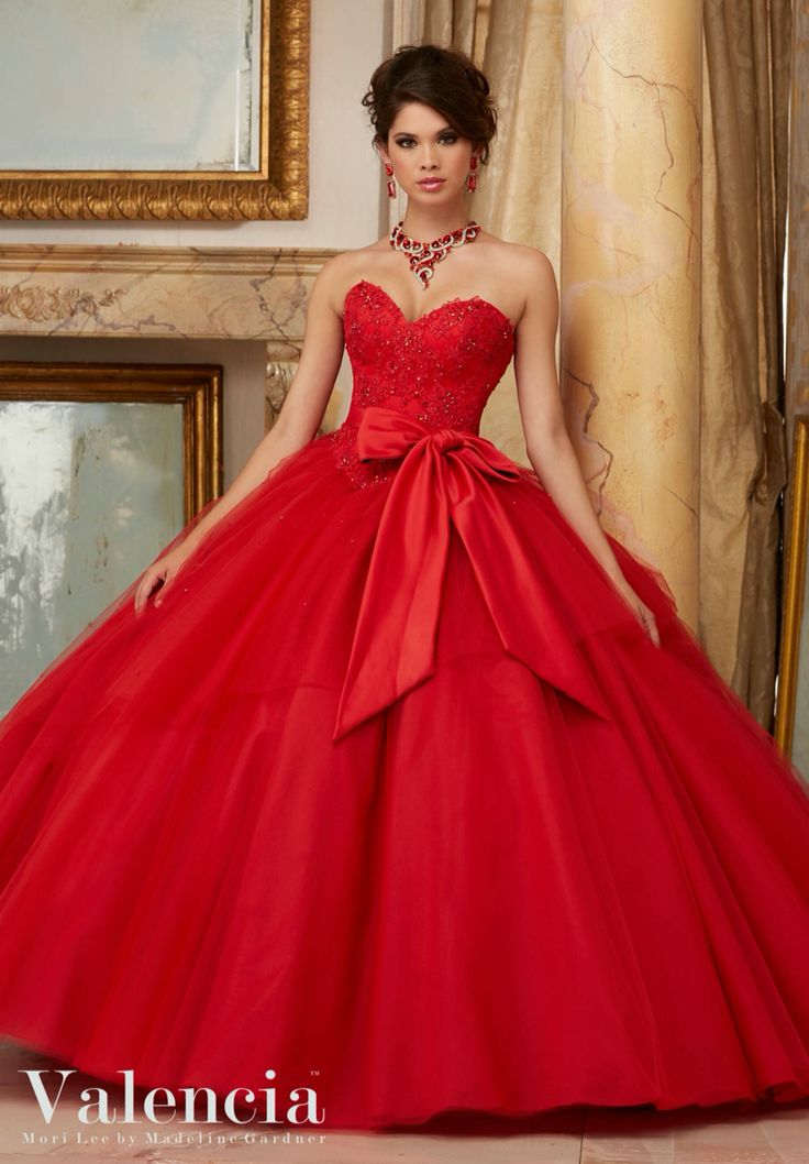 Morilee Valencia Quinceanera Dress 60003 BEADED LACE BODICE WITH FLOUNCED TULLE BALL GOWN Removable Satin Tie Bow. Matching Stole. Colors Available: Blush/Ivory, Scarlet, White Color of this dress: Scarlet