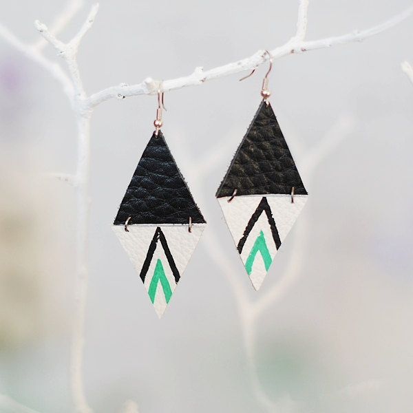 triangle geometric leather earrings / navajo. $12.00, via Etsy.