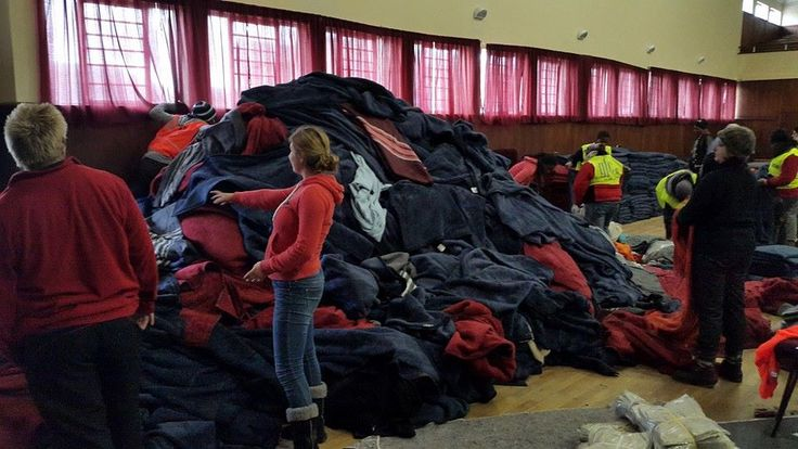 Mountain of blankets to be sorted in the hall