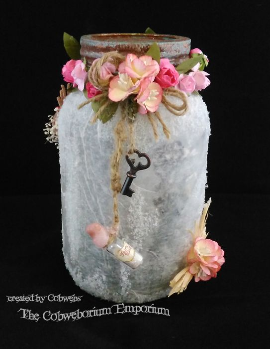 Fairy Jar number 2 from this blog.  So pretty.  Photographs and instructions how to make it can be found on The Cobweborium Emporium