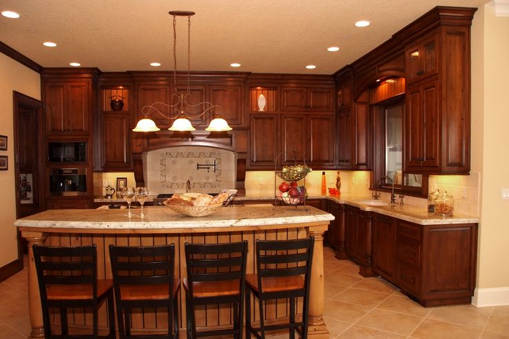 Stained clear alder kitchen cabinets with a beautiful for Custom made kitchens