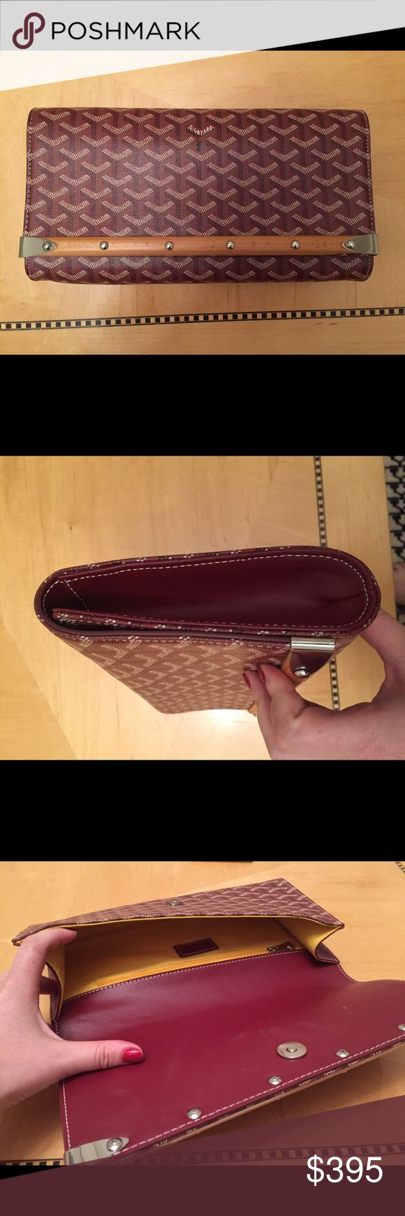 """Goyard clutch bag wallet *open to offers* Great preowned condition with some signs of wear. Measures about 12""""x 1.5"""" x 5"""". Wood trim, silver finishings and a plum colored coated canvas. A stunning gift. Goyard Bags Clutches & Wristlets"""