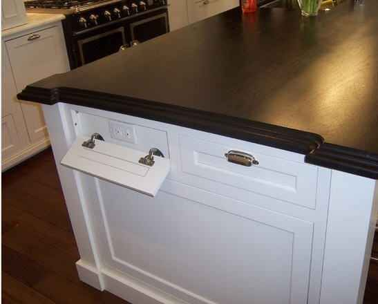 33 Insanely Clever Upgrades To Make To Your Home hide electrical outlets on a kitchen island on cabinets! Childproof by putting a door lock on them