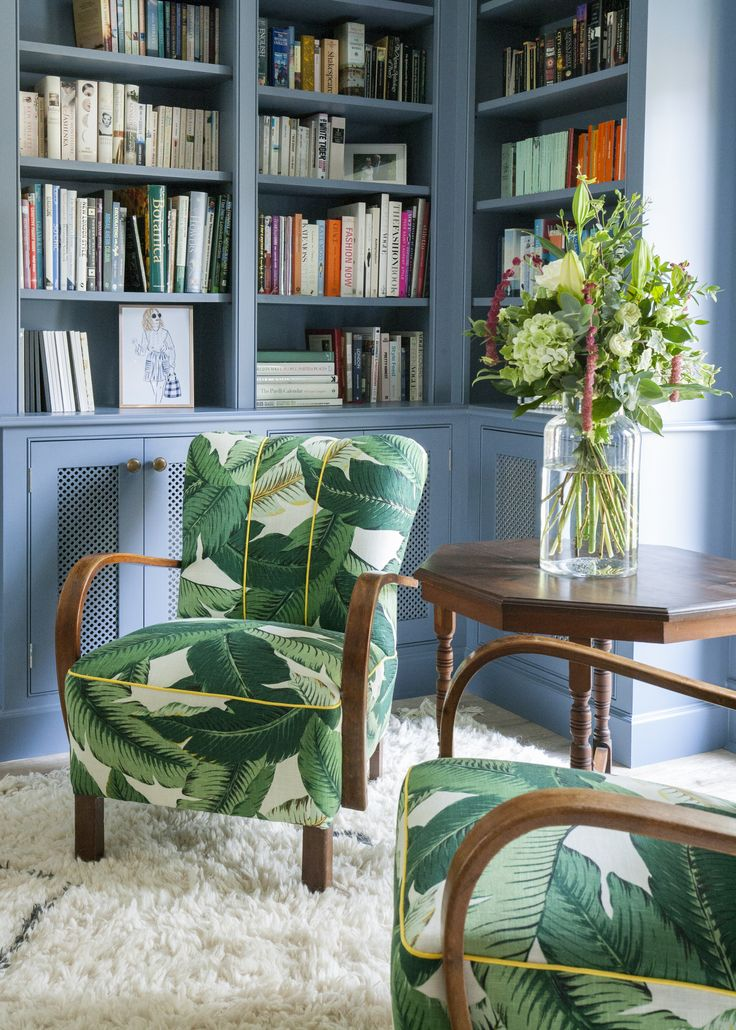 Bookshelves painted out the same colour as the walls and banana palm chairs (chairs found on eBay, fabric from Decorative Things). Erica Davies' home (the-edited.com) photos Eleanor Skan