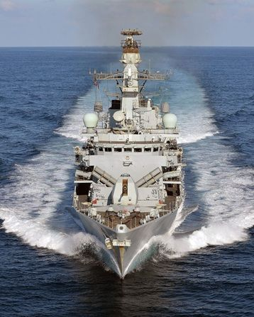"""HMS Kent working with French carrier strike group.Type 23 Frigate assumed vital role protecting French carrier strike group's mission in Middle East.Ushering in new era of British/French military cooperation,Kent taken role of anti submarine warfare commander for French carrier Charles De Gaulle,responsible for protecting group from underwater threats.Will also provide general maritime security using Lynx helicopter as """"eyes"""" & advanced radar systems as """"ears"""". Royal Navy"""