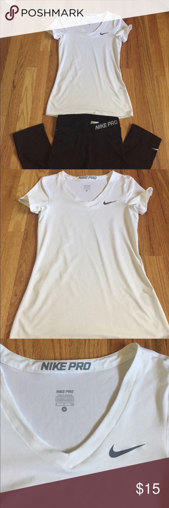 Nike pro work out shirt White v-neck Nike pro shirt. Never worn with no flaws. Material is very absorbing when sweating. Material:84% polyester and 16% spandex Nike Tops