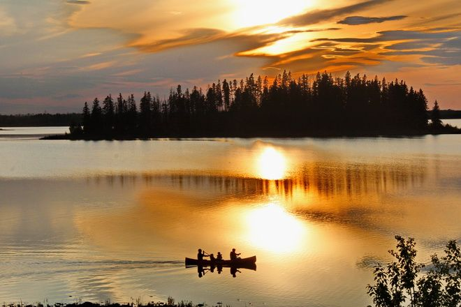 Canoeing at sunset in Elk Island National Park - 21 things to do in Alberta, Canada