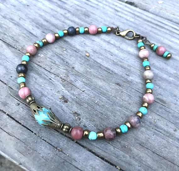 This pretty boho style ankle bracelet is made with rainbow jasper stones, turquoise howlite stones, copper tibetian style beads, copper glass beads, and closes with a copper lobster clasp. Boho anklet comes in several sizes, just choose your size from the drop down menu at checkout.