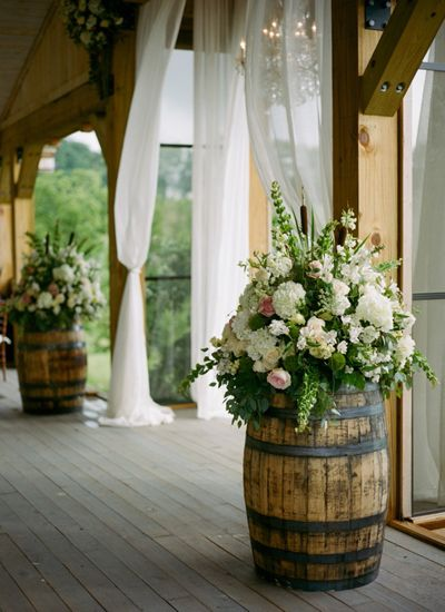 Rustic Wedding Idea: wine barrels with opulent bouquets - Pink Barn Wedding by Kristin Sweeting - Southern Weddings Magazine