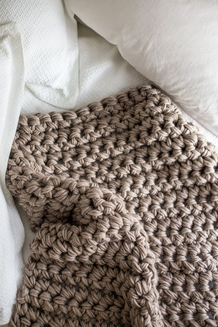 Make this gorgeous hand crochet blanket in only an hour. This stunning, chunky over-sized crochet throw is as luscious and plush as it is easy to make.