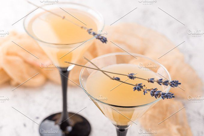 Two glasses with a cocktail martini by Irrin0215 on @creativemarket