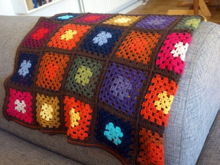 Crochet baby blanket in retro 70s style.