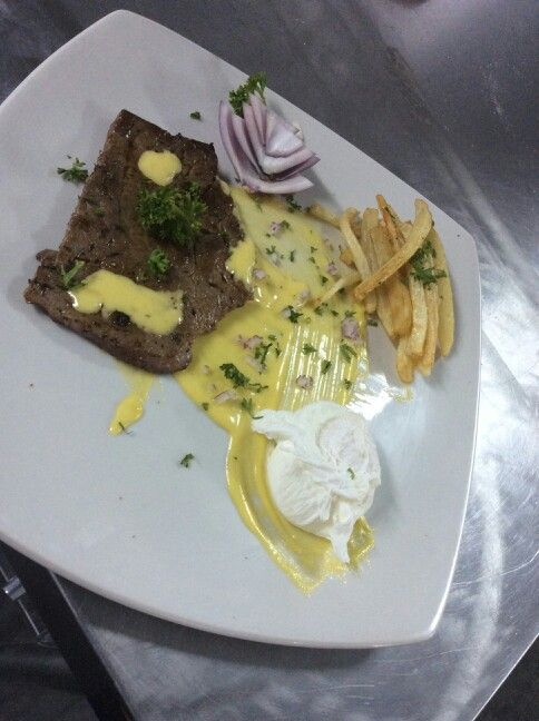 Steak, eggs and chips and aioli sauce