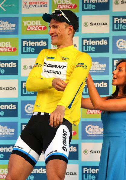 Marcel Kittel Photos Photos - Marcel Kittel of Germany receives the leaders yellow jersey after winning stage one of the Tour of Britain in Liverpool City Centre on September 7, 2014 in Liverpool, England. - Tour Of Britain - Stage One