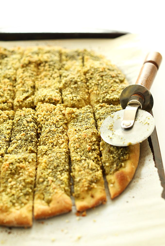 Easy, from scratch vegan pesto breadsticks sprinkled with vegan parmesan cheese. Perfect for serving with pastas or serving as is with marinara sauce.