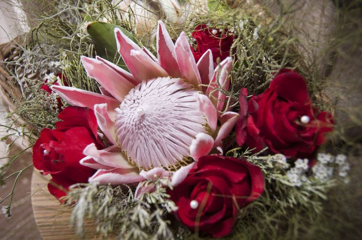 Beautiful bouquet inspiration with proteas and roses, an amazing combination - Search for South African florists by province on South Africa's #1 wedding directory and classifieds! www.saweddinginfo.co.za