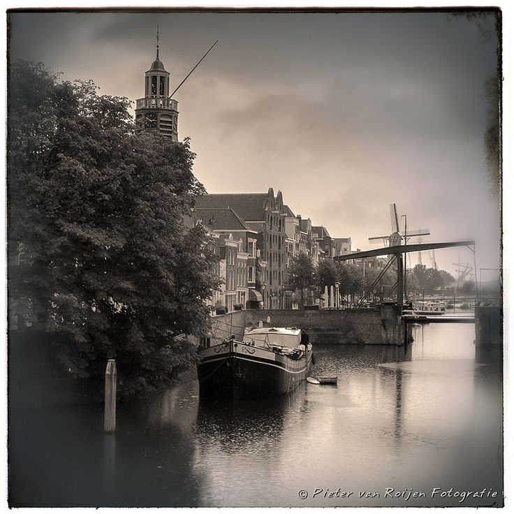 """Delfshaven is a borough of Rotterdam. It was a separate municipality until 1886. On 1 August, 1620 the Pilgrim fathers left Delfshaven with the Speedwell. Since then, the town's Oude Kerk has also been known as the Pelgrimskerk, or in English, the """"Pilgrim Fathers Church"""". You can see this church on the left.  Made with Fuji X20 NIK Analog Efex Pro2"""