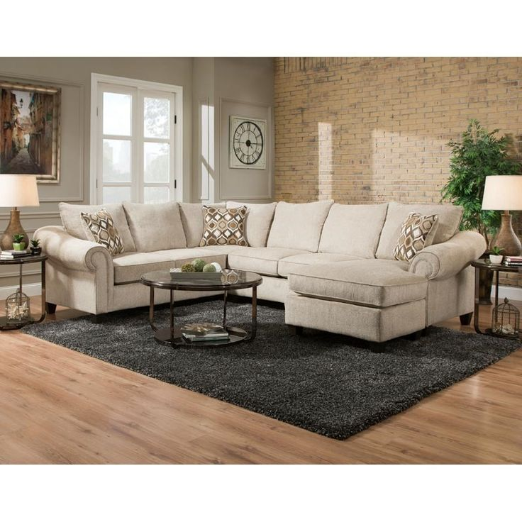 The Caravan 2 Piece Sectional comes in light cream on the cushions and padded armrests. Extra roomy seating big enough for gatherings with family or friends. Cozy wrap-around style completes a room with a touch of classic elegance. Caravan Beige Chenille Reversible Chaise Sectional | Weekends Only Furniture and Mattress