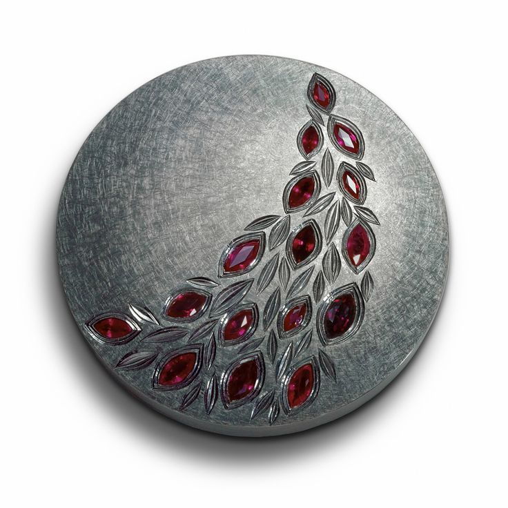 """""""Brooch for a black prince"""" by Alan Craxford. Hand-engraved silver finished in black rhodium with marquise rubies. 2008/9."""