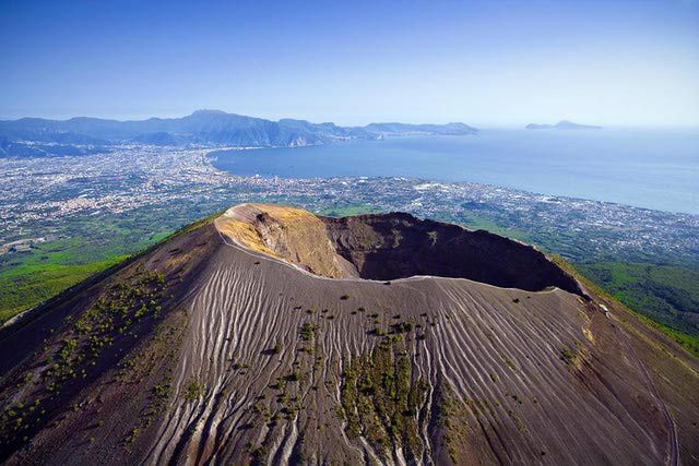 Mount Vesuvius, the massive, active volcano that looms over the Bay of Naples, was responsible for the destruction of Roman towns Pompeii and Herculaneum in 79 AD. Vesuvius last erupted in 1944. Allied fliers took photos of the eruption.
