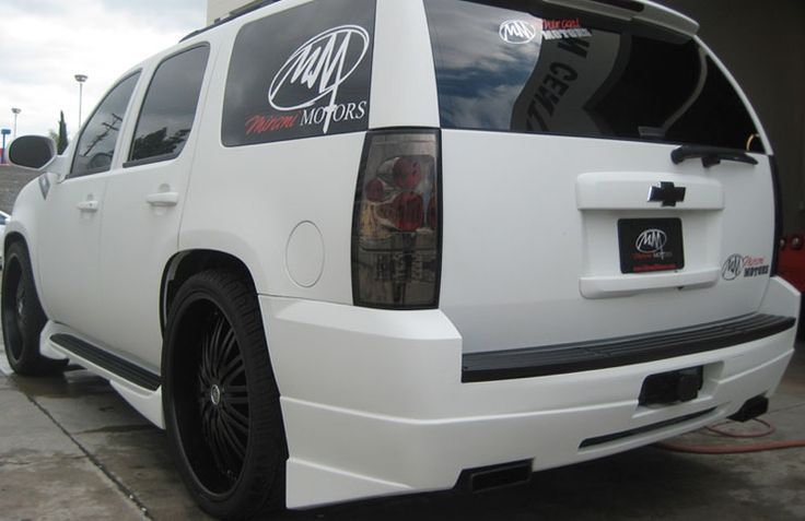 2010 Egg Shell Matte-White Chevrolet Tahoe with smoked lights, tinted windows, black badges, and black rims