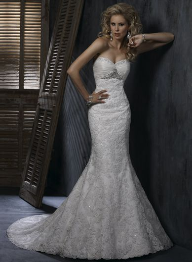 Sweetheart Trumpet / Mermaid Ruffle Lace bridal gown. Like the dress, accept