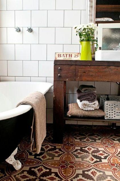 spanish encaustic floor tiles in this eclectic bathroom by etica studio are fabulous