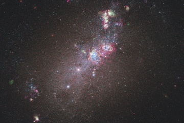 This full-field image of the nearby dwarf galaxy NGC 4214 taken with NASA's Hubble Space Telescope.