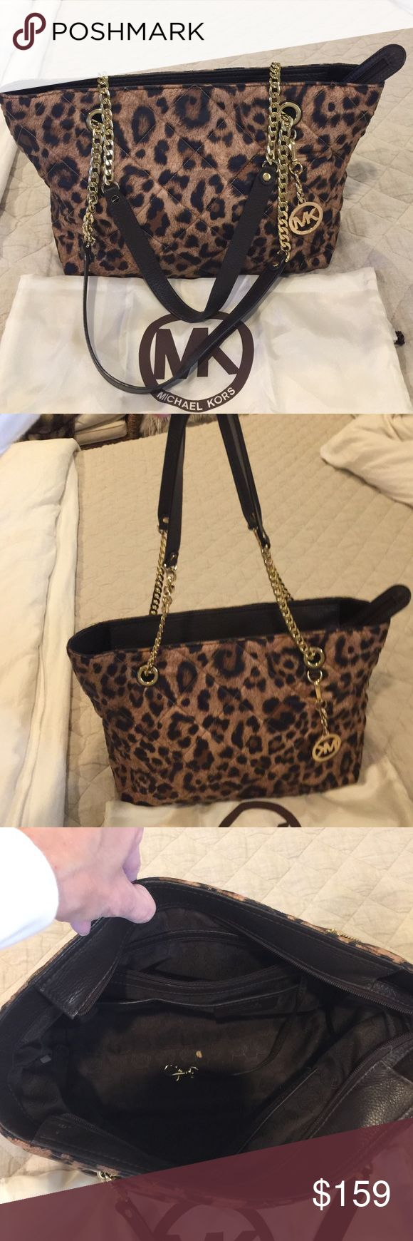 Michael Kors animal print bag Like new! Soft quilted material. Brown leather. Gold chain handles and MK. Zip top closure. No signs of wear. Michael Kors Bags Shoulder Bags