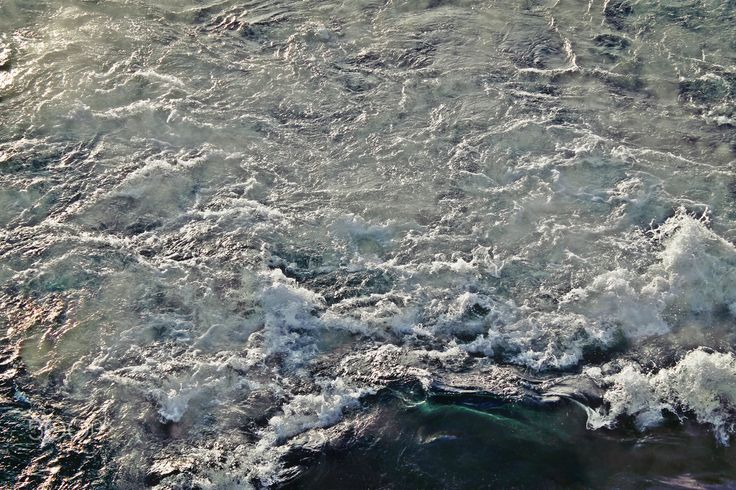 River Foam with Waves - Foam on hot river water with small waves.