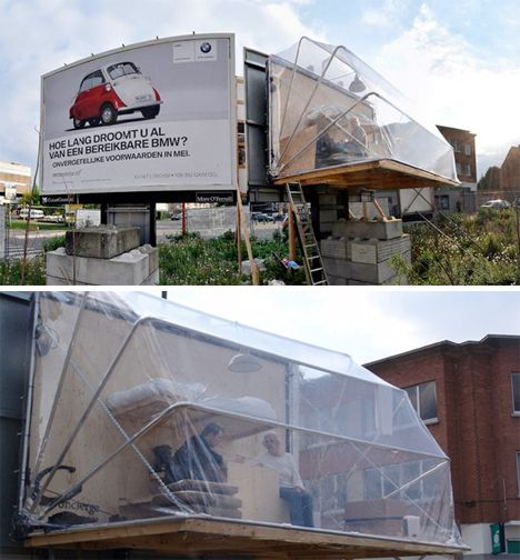 """Reclaimed Billboard Houses 4 According to Philips' biography, he is particularly interested in the margins of society, focusing on """"themes such as gaps in legal, economic and social systems, the omnipresence of advertisement, unrestrained capitalism and consumerism, etc."""" His previous work includes a parasite apartment built onto the back of a conventional billboard, invisible from the street."""