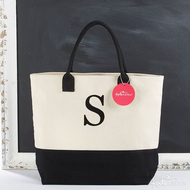 Are you going for a classic wedding look with a black and white palette? Fill a tote bag with an emergency kit, an elegant mirror compact for touch-ups, and a bottle of water with matching custom labels. | Black And White Monogrammed Tote | KateAspen.com