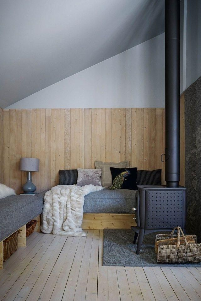 Built-in settees double as extra beds in Swiss Alps ski house.