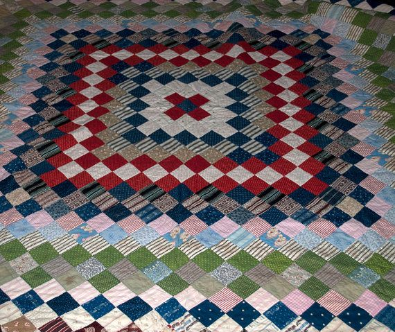 Quality Pieced Quilt, Early 20th Century -  Lovely color and composition, and in very good condition, a pretty and functional hand pieced antique quilt. Made with charming calico cotton prints in colors of red, white, blue, green, and pink. Would be great as a display piece, throw, or as intended.