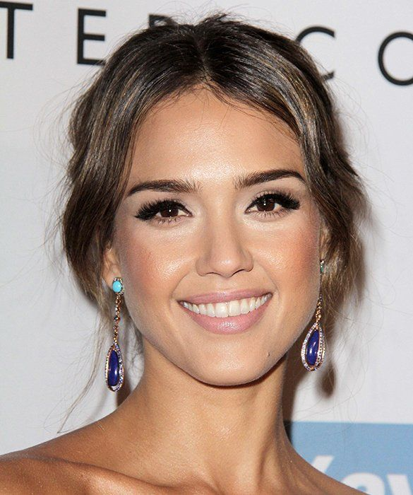 Sometimes simple is the way to go. Copy Jessica Alba's effortless hairstyle by parting the front section of mid-length bangs down the center and brushing the rest back into a simple bun at the nape of your neck secured with bobby pins. If your hair is naturally wavy, you're all done, but if you need to create waves in the face-framing bang section, use a large barrel curling iron and a mist of hairspray to set the look.