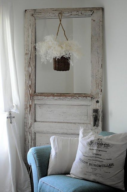 I have an old french door propped on the wall between the buffet and couch. Would love to find another old door to use somewhere else!