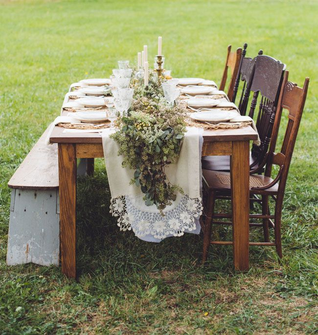 Fall Farm-Style Wedding Inspiration, long farm table with antique linens and chairs. Mossy floral runner down the center