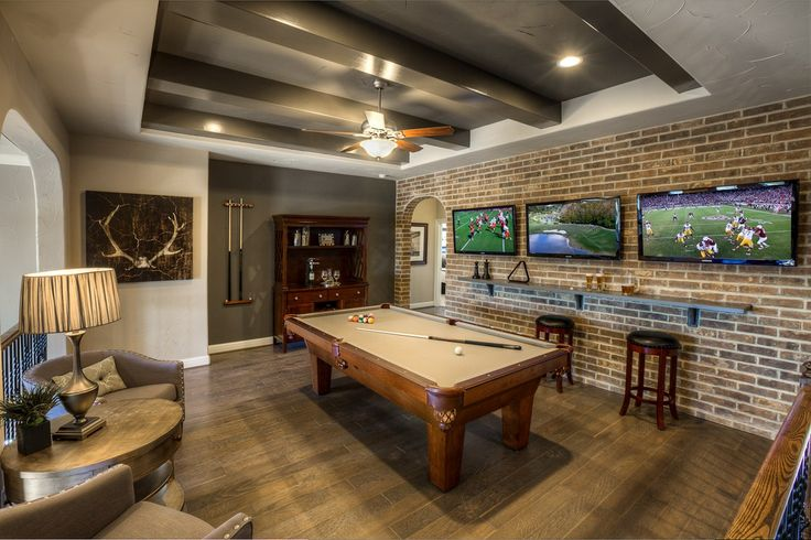 A Brick Accent Wall And Dramatic Beams Add A Timeless Look