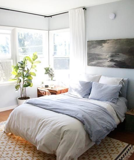 White + chambray bedding, gray bedroom walls