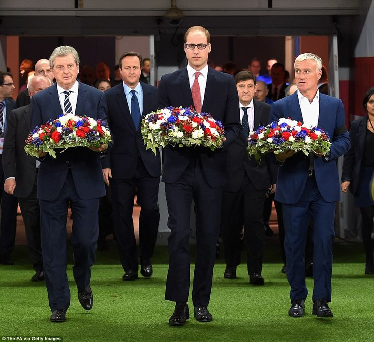 Tribute: Prince William took to the Wembley pitch with England manager Roy Hodgson (left) and French coach Didier Deschamps (right) to lay floral tributes ahead of the international friendly between England and France at Wembley Stadium this evening